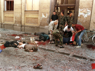 Gravely wounded civilians lie outside a Sarajevo market in center of the Bosnian capital on Aug. 28, 1995, during which 40 people were killed. (Reuters).