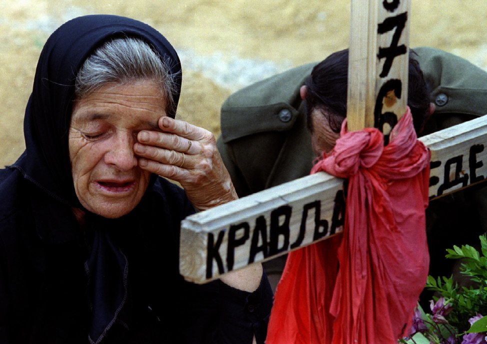 A woman weeps over the grave of her grandson in Sarajevo, a soldier in the Bosnian Serb forces, who was killed in 1993. (Reuters)