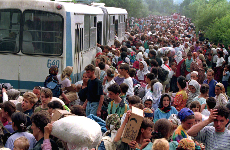 Around 10.000 refugees from Srebrenica board buses at a camp outside the UN base heading for other refugee camps in the Tuzla area on Bosnia-Herzegovina in July 1995 (Reuters)