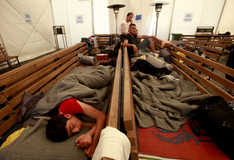 Syrian refugees rest on benches inside a tent at the transit center for refugees near southern Macedonia's town of Gevgelija, on the border with Greece on April 4, 2016.  (AP)