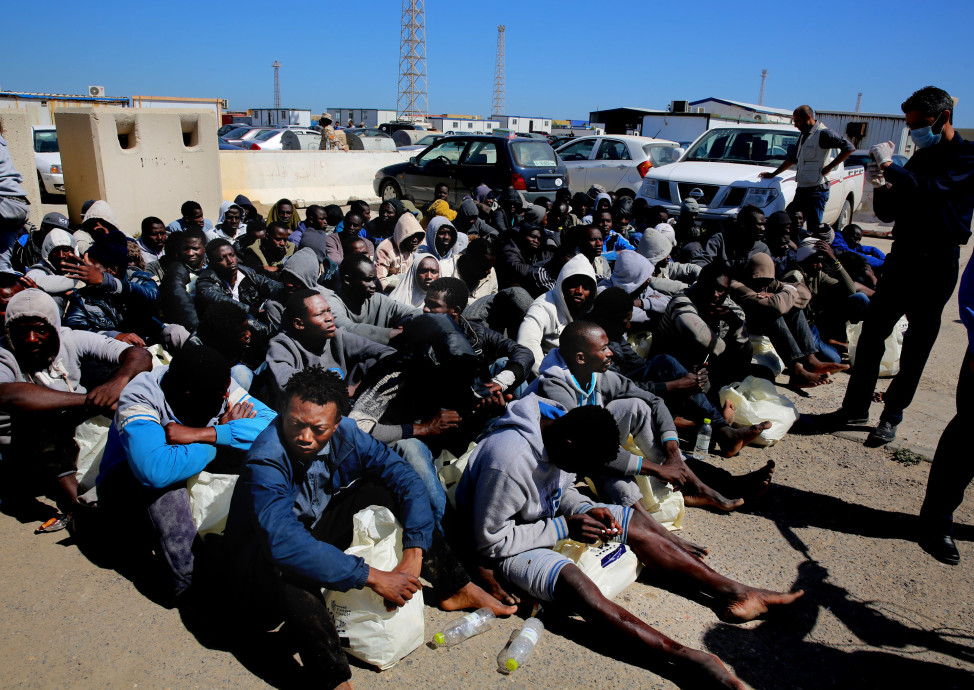 Illegal African migrants wait to receive medical assistance after being rescued in a port in Tripoli on April 11, 2016. (AP)