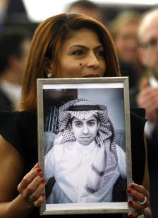 Ensaf Haidar, wife of the jailed Saudi blogger Raif Badawi, holds a portrait of her husband as he is awarded with the Sakharov Prize on Dec, 16, 2015. (AP)