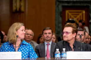 UN High Commissioner for Refugees Deputy High Commissioner Kelly Clements, left, and Irish rock star and activist Bono, right, arrive to testify at the senate on Capitol Hill on April 12, 2016. (AP)