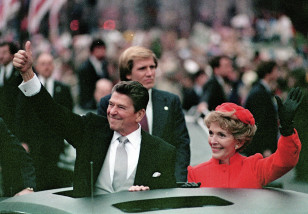President Ronald Reagan plays to the crowd as his wife, First Lady Nancy Reagan, waves from limousine during the inaugural parade in this Jan. 20, 1981 file photo. (AP)