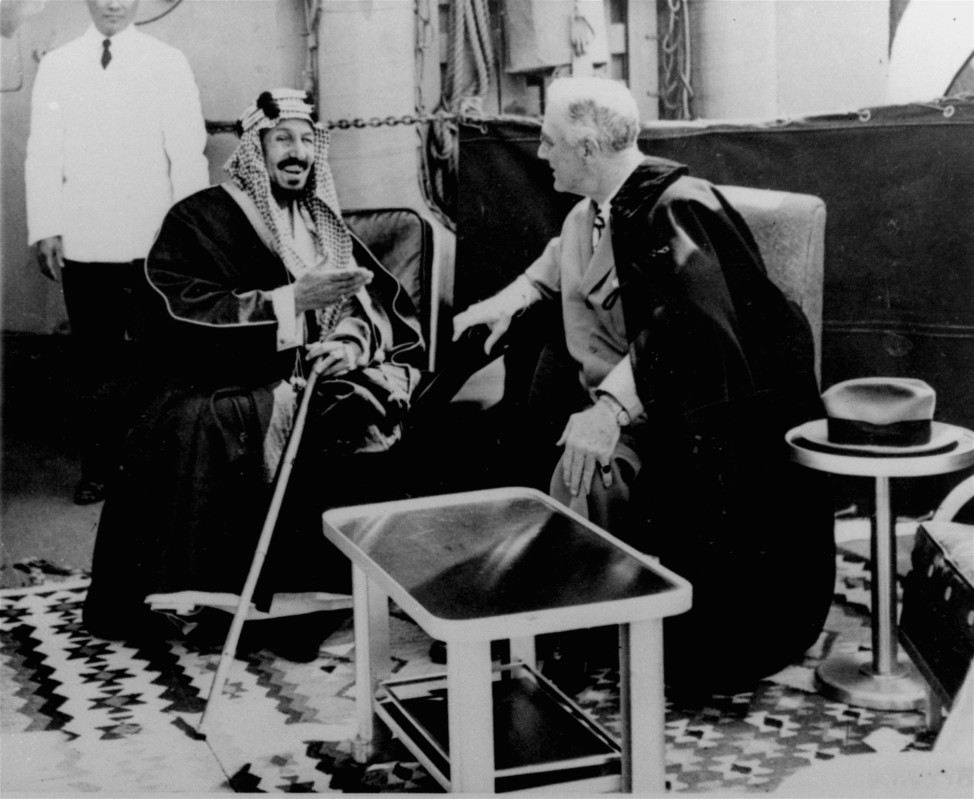 President Franklin D. Roosevelt and King Abdul Aziz Ibn Saud discuss Saudi-US relations aboard USS Quincy in the Great Bitter Lake north of the city of Suez, Egypt on Feb. 14, 1945.  (AP file photo)