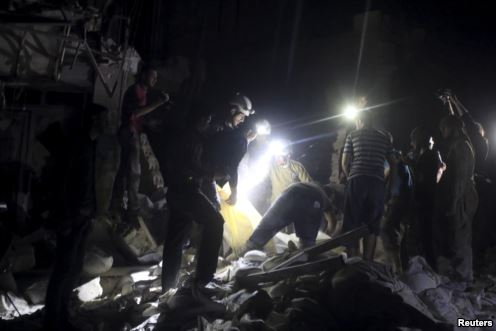 Civil defense members search for survivors after an airstrike at a field hospital in the rebel held area of al-Sukari district of Aleppo, Syria, April 27, 2016.