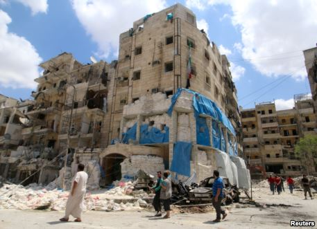 People inspect the damage at al-Quds hospital after it was hit by airstrikes in a rebel-held area of Syria's Aleppo, April 28, 2016.