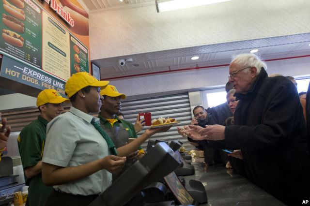 Democratic presidential candidate, Sen. Bernie Sanders, I-Vt., orders hot dogs at Nathans Famous in Coney Island in the Brooklyn, New York, Sunday, April 10, 2016.