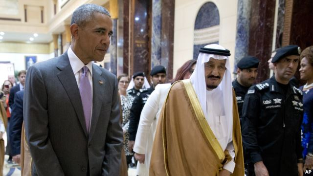 President Barack Obama and Saudi Arabia's King Salman walk together to a meeting at Erga Palace in Riyadh, Saudi Arabia, April 20, 2016.