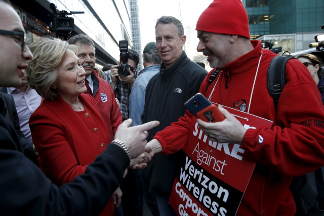 Democratic presidential candidate Hillary Clinton greets picketing Verizon workers who are out on strike in New York City April 13, 2016. (Reuters)