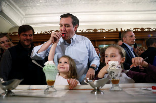 Republican presidential candidate Ted Cruz samples ice creeam with his daughters at a campaign event in Columbus, Indiana on April 25, 2016. (Reuters)