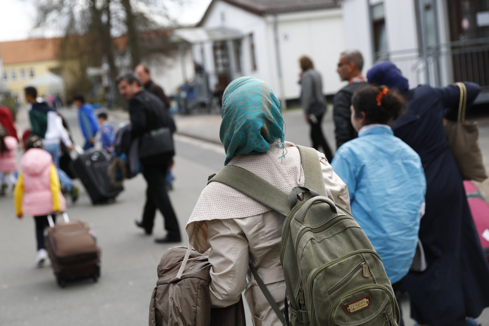 Syrian refugees arrive at camp in Friedland, Germany on April 4, 2016. (Reuters)