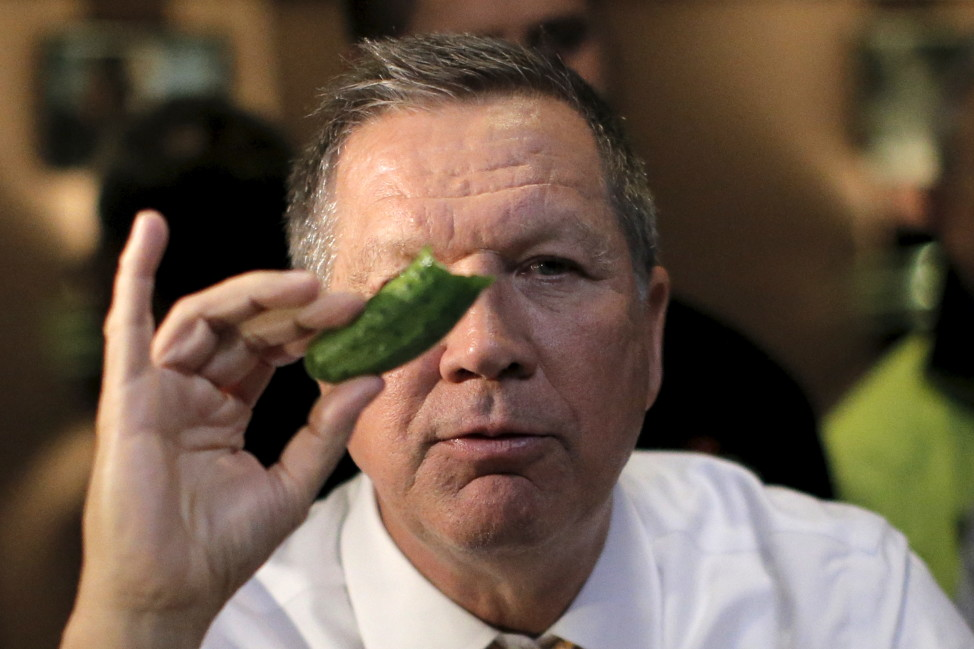 Republican presidential candidate John Kasich eats a pickle at PJ Bernstein's Deli Restaurant in New York City on April 16, 2016. (Reuters)
