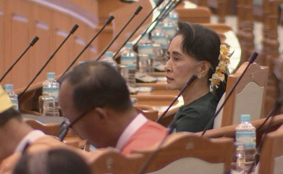 National League for Democracy leader Aung San Suu Kyi is seated with other members of parliament before they cast their ballots for the country's new president in Naypyitaw, Myanmar on March 15, 2016. (AP)