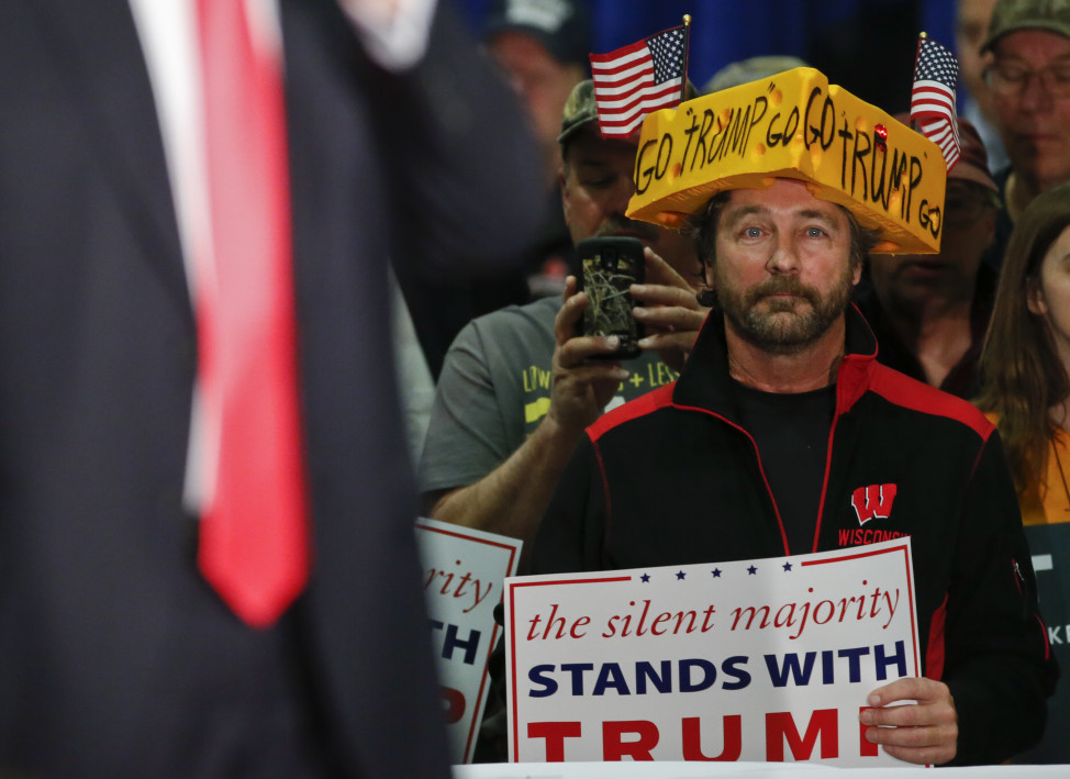 A supporter listens to Republican presidential candidate Donald Trump  during a town hall event in La Crosse, Wisconsin April 4, 2016. (Reuters)