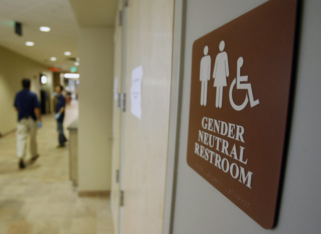 In this Aug. 23, 2007, file photo, a sign marks the entrance to a gender-neutral restroom at the University of Vermont in Burlington, Vt. Nearly all of the nation's 20 largest cities, including New York City, have local or state nondiscrimination laws that allow transgender people to use whatever bathroom they identify with, though a debate has raged around the topic nationwide, including North Carolina. (AP)