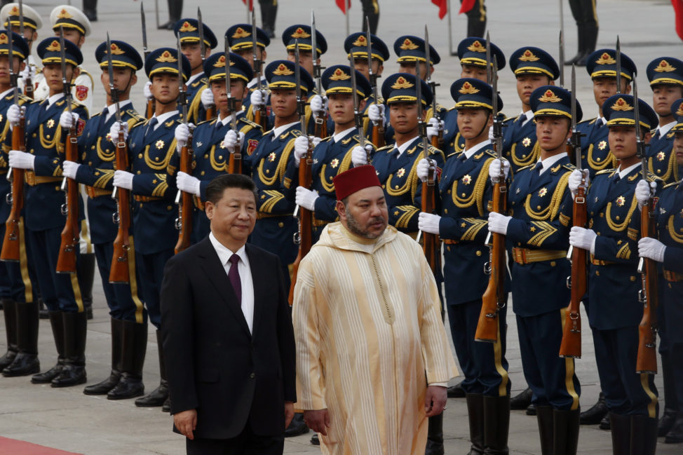 China's President Xi Jinping, left, and Moroccan King Mohammed VI walk as they inspect the Chinese honor guard during a welcoming ceremony outside the Great Hall of People in Beijing, China, May 11, 2016. (AP)
