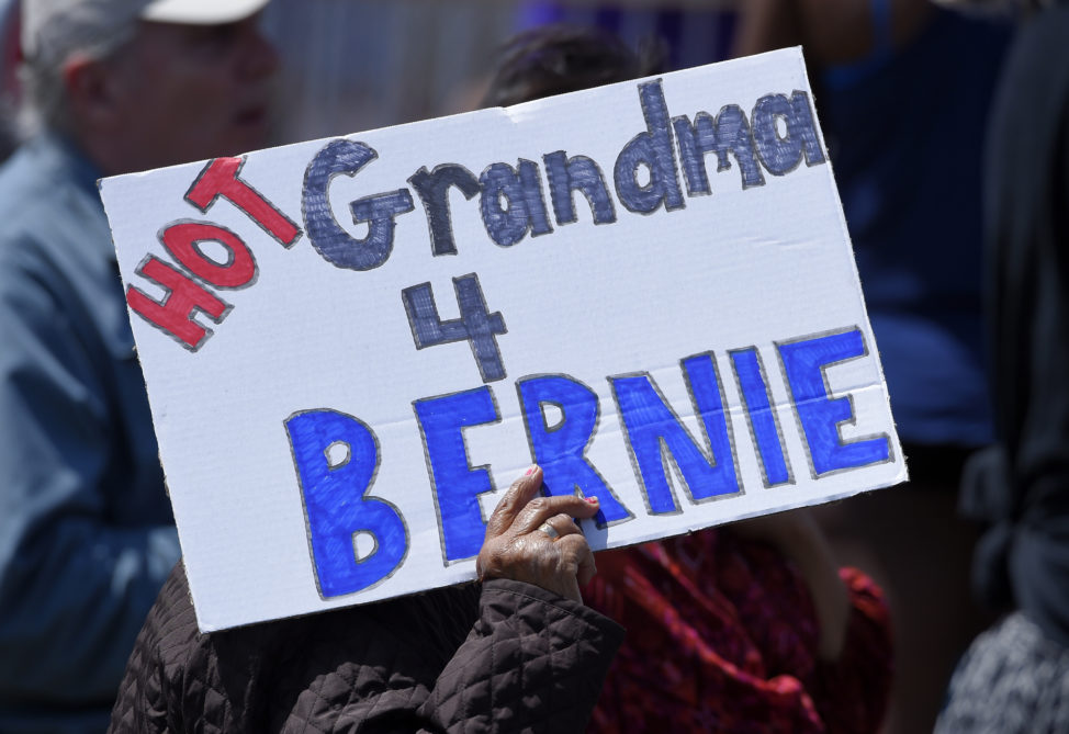A supporter holds up a sign for Democratic presidential candidate Sen. Bernie Sanders, I-Vt., speaks at a campaign rally, Saturday, May 28, 2016, in Santa Maria, Calif. (AP)
