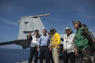 Defense Secretary Ash Carter and Philippine Defense Secretary Voltaire Gazmin tour the flight deck of the USS John C. Stennis in the South China Sea, April 15, 2016. (DoD photo)