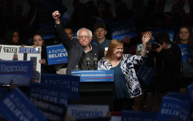 Democratic presidential candidate Sen. Bernie Sanders pumps his first in the air to the crowd after his wife Jane (R) came onstage and whispered in his ear as he spoke to supporters at a campaign event held during Indiana primary day at Waterfront Park in Louisville, Kentucky May 3, 2016. (Reuters)