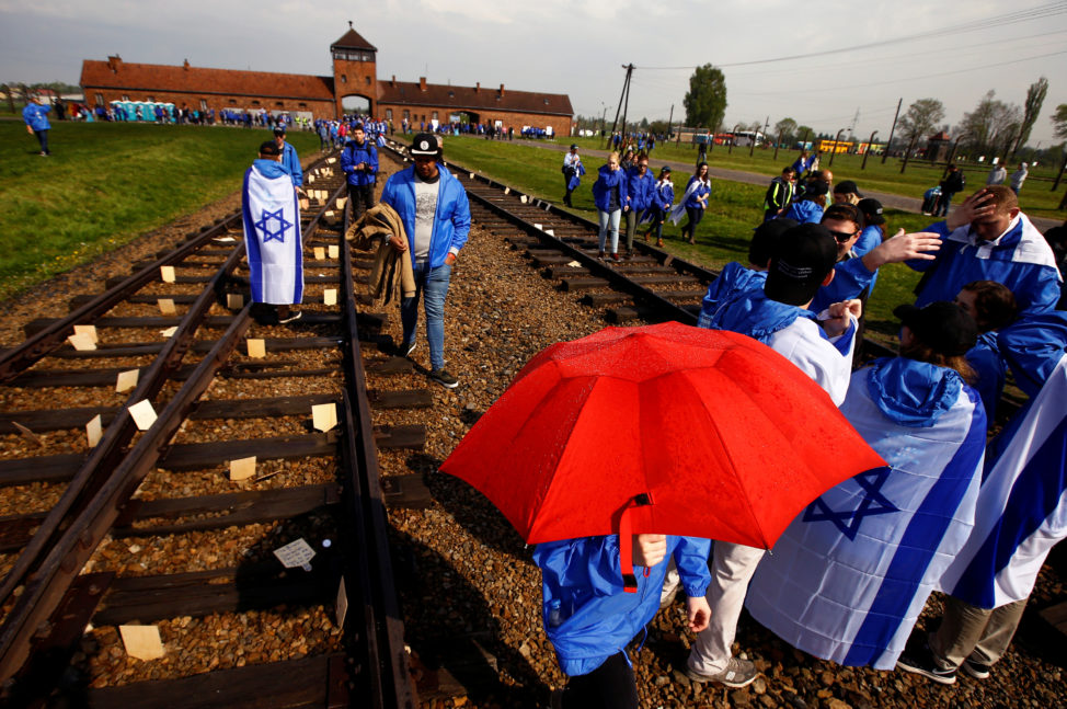 "People march in the former Nazi death camp of Auschwitz-Birkenau (Auschwitz II) as thousands of people, mostly youth from all over the world gathered for the annual ""March of the Living"" to commemorate the Holocaust in Brzezinka near Oswiecim, Poland May 5, 2016. (Reuters)"