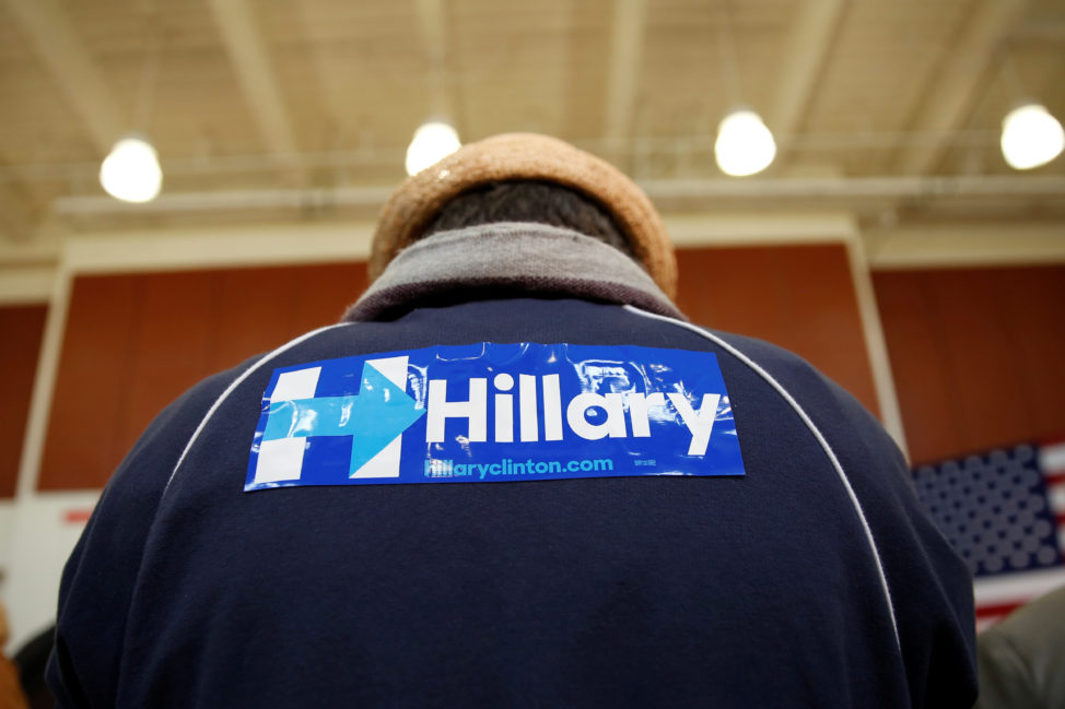 An attendee wears a sticker on his jacket in support of U.S. Democratic presidential candidate Hillary Clinton during a rally at La Escuelita School in Oakland, California, U.S., May 6, 2016.  (Reuters)