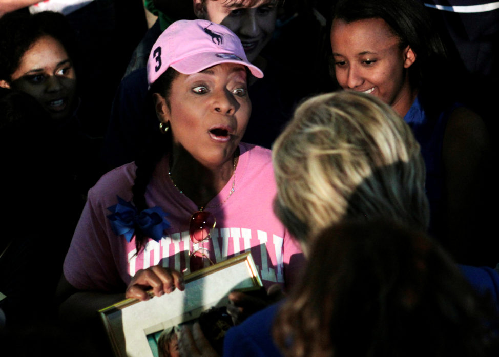 A campaign supporter reacts to meeting U.S. Democratic presidential candidate Hillary Clinton during a campaign rally in the Hall of Fame Pavilion at Louisville Slugger Field in Louisville, Kentucky, U.S., May 10, 2016. REUTERS/John Sommers II    - RTX2DQCU