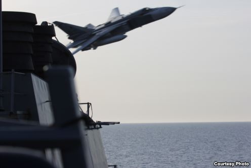 Image of Russian fly-over near guided-missile destroyer USS Donald Cook in Baltic Sea as provided by the U.S. Navy 6th Fleet. (U.S. Navy Photo)