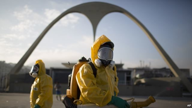 FILE - Health workers spray insecticide in the Sambadrone to combat the Aedes aegypti mosquito that transmits the Zika virus, in Rio de Janeiro, Brazil, Jan. 26, 2016. The Sambadrome will be among the venues at this year's Summer Games in Rio.