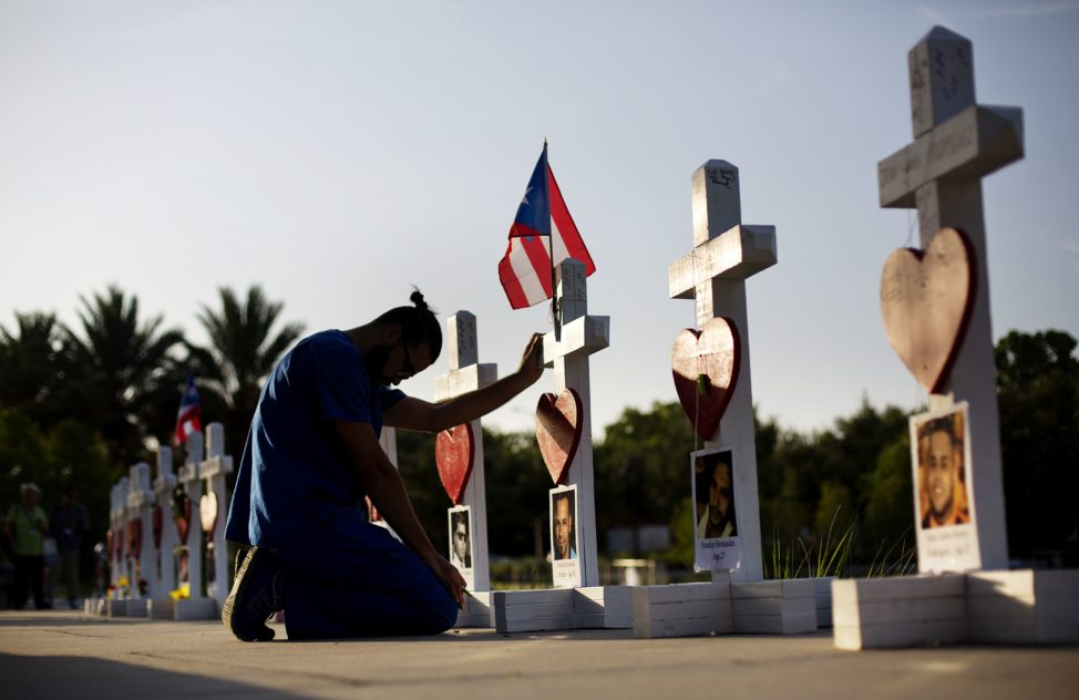 Ernesto Vergne prays at a cross honoring his friend Xavier Emmanuel Serrano Rosado and the other victims at a memorial to those killed in the Pulse nightclub mass shooting a few blocks from the club early Friday, June 17, 2016, in Orlando, Fla. (AP)