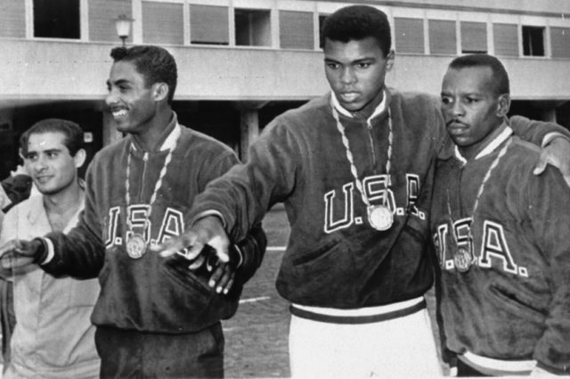 A trio of U.S. boxers wear gold medals at the Olympic village in Rome, September 6, 1960. From the left are: Wilbert McClure of Toledo, Ohio, light middleweight; Cassius Clay of Louisville, KY, light heavyweight; and Edward Crook of Fort Campbell, KY, middleweight. (AP)