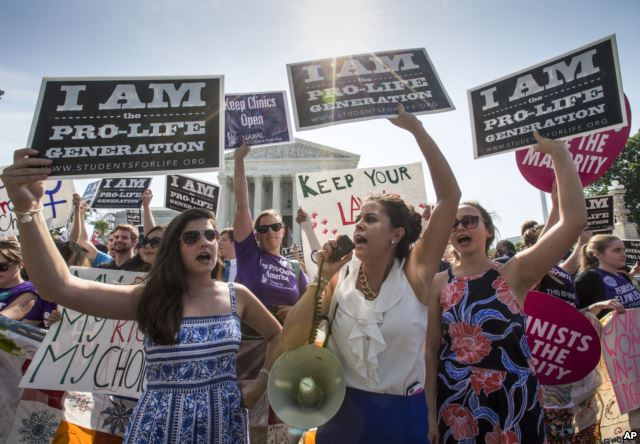 Reagan Barklage of St. Louis, center, and other anti-abortion activists demonstrate in front of the Supreme Court in Washington, Monday, June 27, 2016, as the justices struck down the strict Texas anti-abortion restriction law known as HB2. (AP)