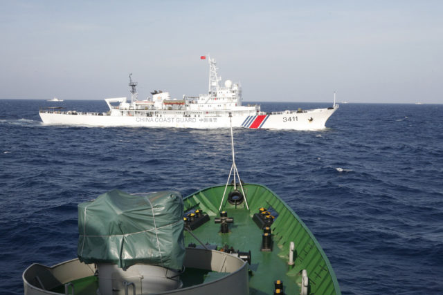 A ship (top) of Chinese Coast Guard is seen near a ship of Vietnam Marine Guard in the South China Sea, about 210 km (130 miles) off shore of Vietnam May 14, 2014. Vietnamese ships were followed by Chinese vessels as they neared China's oil rig in disputed waters in the South China Sea on Wednesday, Vietnam's Coast Guard said. Vietnam has condemned as illegal the operation of a Chinese deepwater drilling rig in what Vietnam says is its territorial water in the South China Sea. (Reuters)