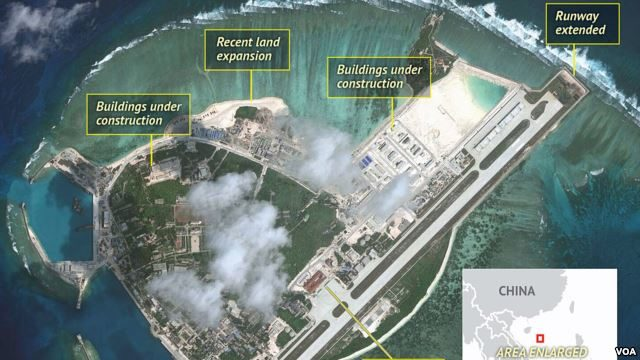 FILE - Satellite imagery analysis by geopolitical intelligence firm Stratfor shows overall land, building and military expansion by China on Woody Island in the South China Sea. (Courtesy of Stratfor)