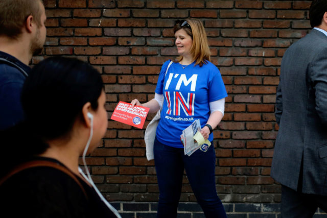 A woman hands out leaflets campaigning to stay in Europe for the BREXIT vote in London, Britain, May 20, 2016. (Reuters)