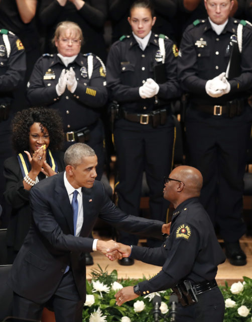 President Barack Obama, left, shakes hands with Dallas Police Chief David Brown during a memorial service for the five slain Dallas police officers. Tuesday, July 12, 2016 (AP)