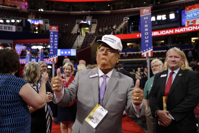 Georgia delegate Bubba McDonald poses for picture as he wears a mask of Republican Presidential Candidate Donald Trump before the final day of the Republican National Convention in Cleveland, Thursday, July 21, 2016. (AP)
