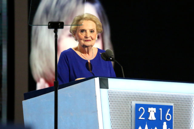 "Former U.S. Secretary of State Madeleine Albright, the first woman to hold that post, addresses the crowd at the Wells Fargo Arena in Philadelphia on day two of the Democratic National Convention. Albright said Hillary Clinton ""knows that safeguarding freedom and security is not like hosting a TV reality show."" July 26, 2016 (A. Shaker/VOA)"