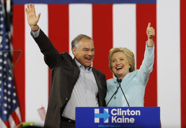 Democratic U.S. vice presidential candidate Senator Tim Kaine (D-VA) waves with his presidential running-mate Hillary Clinton after she introduced him during a campaign rally in Miami, Florida, U.S. July 23, 2016. (Reuters)