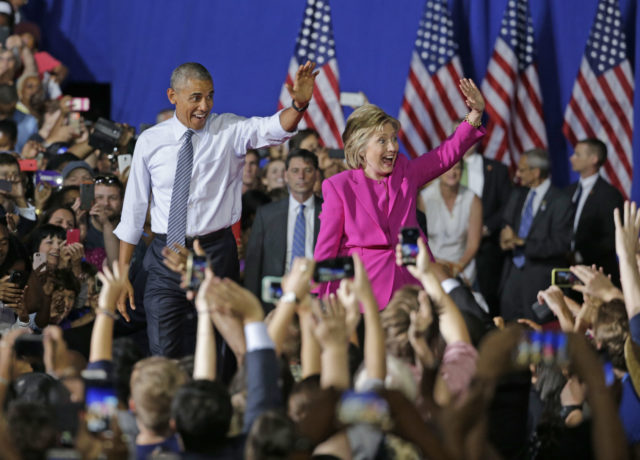 President Barack Obama and Democratic presidential candidate Hillary Clinton wave to the crowd during a campaign rally for Clinton in Charlotte, N.C., Tuesday, July 5, 2016. (AP)