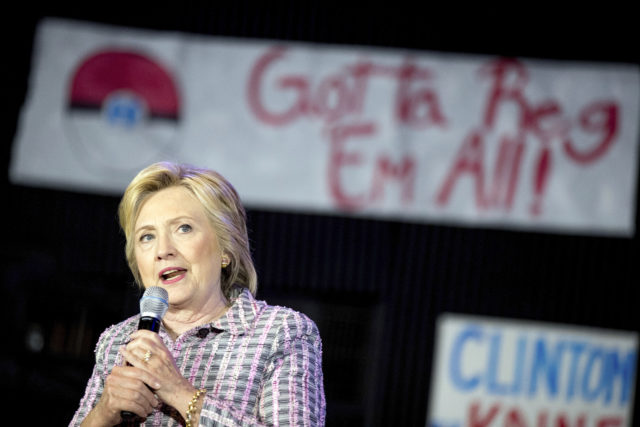 Hillary Clinton speaks to volunteers at a Democratic party organizing event at the Neighborhood Theater in Charlotte, N.C. A Pokemon poster is visible behind her. July 25, 2016. (AP)