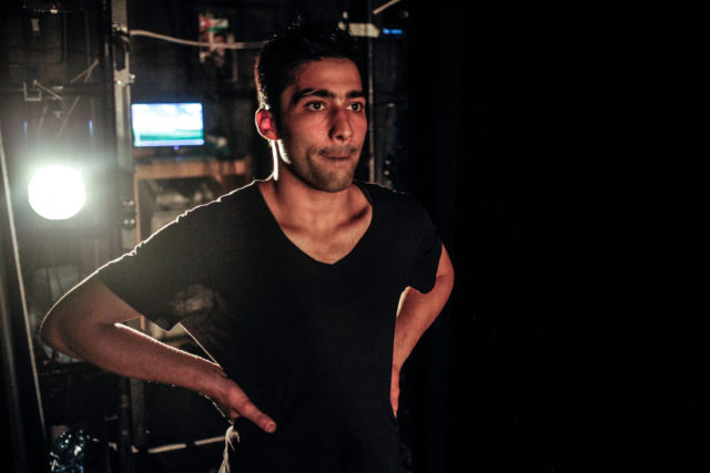 In this April 16, 2015 file photo, Adil Faraj waits backstage for the cue to begin his final rehearsal before his on-stage debut at the Amman Contemporary Dance Festival in Amman, Jordan. Faraj was buying clothes in the neighborhood of Karada for the Islamic holiday of Eid al-Fitr that marks the end of the holy month of Ramadan when a suicide truck bomb exploded, killing him and more than 175 others.