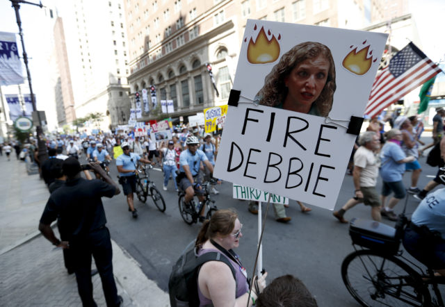 A supporters of Sen. Bernie Sanders, I-Vt., holds up a sign call calling for Debbie Wasserman Schultz, chairwoman of the Democratic National Committee to be fired, Sunday, July 24, 2016, in Philadelphia. The Democratic National Convention starts Monday. (AP)