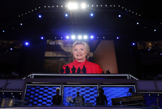 Democratic Presidential candidate Hillary Clinton appears on the screen during the second day session of the Democratic National Convention in Philadelphia, Tuesday, July 26, 2016. (AP)