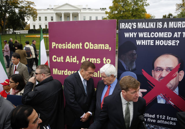 FILE - Former U.S. Secretary of Homeland Security Tom Ridge (3rd R), former House Speaker Newt Gingrich (R-GA) (2nd R), and former U.S. Representative Patrick Kennedy (D-RI) (R) rally with supporters of Iranian opposition group Mujahedin-e Khalq (MEK) as they protest against Iraq's Prime Minister Nuri al-Maliki  hours before he is scheduled to meet with U.S. President Barack Obama, at the White House in Washington, November 1, 2013. (REUTERS)