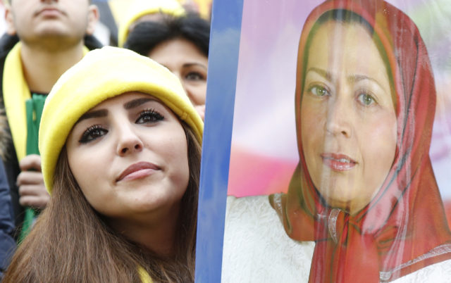 FILE - A demonstrator holds a placard showing a portrait of Maryam Rajavi, President of the National Council of Resistance of Iran (NCRI), during a protest against Iran's President Hassan Rouhani visit to France in central Paris, France, January 28, 2016.  (REUTERS)