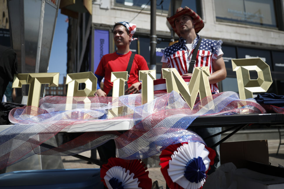 Vendors sell Trump branded items outside the Republican National Convention on Tuesday, July 19, 2016, in Cleveland, during the second day of the Republican convention. (AP Photo/John Minchillo)