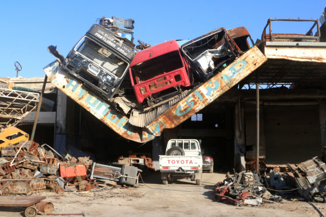 Damaged vehicles pile on a damaged roof of a car mechanic service center in Ramousah area southwest of Aleppo, Syria August 2, 2016. Picture taken August 2, 2016. (Reuters)
