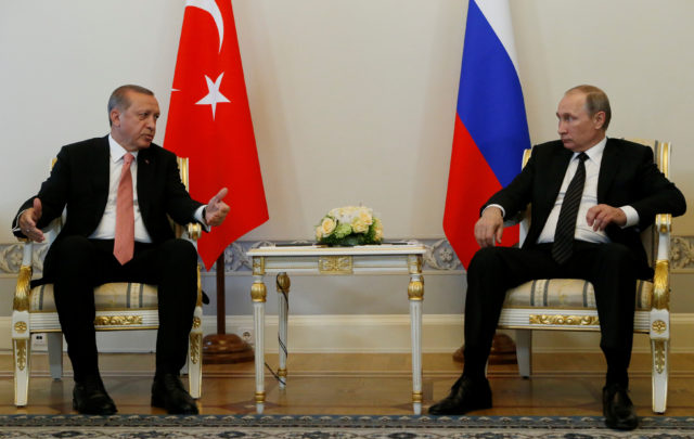 Turkish President Tayyip Erdogan speaks to Russian President Vladimir Putin (R) during their meeting in St. Petersburg, Russia, August 9, 2016. (Reuters)