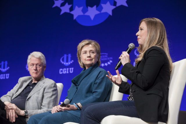 Former President Bill Clinton (L) and former Secretary of State Hillary Clinton (C) listen to their daughter and Vice Chair of the Clinton Foundation Chelsea Clinton during the second day of the 2014 Meeting of the Clinton Global Initiative at Arizona State University in Tempe, Arizona March 22, 2014. (Reuters)
